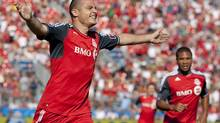 Toronto FC 's Danny Koevermans (left) celebrates scoring his team's first goal against New England Revolution as Ryan Johnson looks on during first half MLS action in Toronto on Saturday June 23, 2012. (Chris Young/THE CANADIAN PRESS)