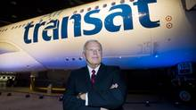 Air Transat president Allen Graham poses for a photograph next to an Airbus A330 in May, 2012. Mr. Graham will be stepping down from his position in June, 2013, roughly two months after the company announced its first layoffs since 2011. (Graham Hughes/The Canadian Press)