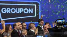 Employees and guests of Groupon ring the opening bell in celebration of the company's IPO at the Nasdaq Market in New York on Nov. 4, 2011. (BRENDAN MCDERMID/BRENDAN MCDERMID/REUTERS)