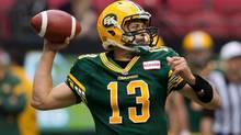 Edmonton Eskimos' quarterback Mike Reilly passes during the first half of a pre-season CFL football game against the B.C. Lions in Vancouver, B.C., on Friday June 21, 2013. Success for the Edmonton Eskimos is 2013 rests on five mountain-sized men who barely know each other protecting the CFL team's third opening-day quarterback in three years. (DARRYL DYCK/THE CANADIAN PRESS)