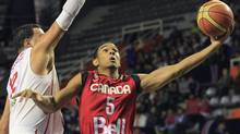 Canada's Cory Joseph, right, goes for a layup against Puerto Rico's Manuel Narvaez during a FIBA Americas Championship basketball game in Mar del Plata, Argentina, Tuesday, Sept. 6, 2011. (Associated Press)