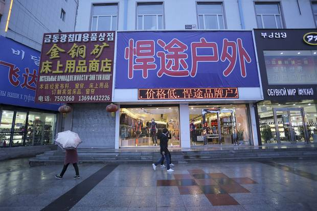 Korean-, Chinese- and Russian-language signs hang above the stores in Hunchun, a Chinese city sandwiched between North Korea and Russia.