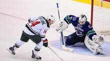 Minnesota Wild forward Justin Fontaine scores against Vancouver Canucks goaltender Eddie Lack in a shootout at Rogers Arena. (Anne-Marie Sorvin/USA Today Sports)