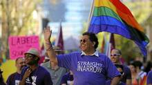 Mayor Naheed Nenshi leads the gay pride parade in Calgary, Alberta, Sept. 4, 2011. (Todd Korol for The Globe and Mail/Todd Korol for The Globe and Mail)