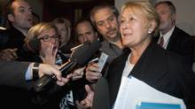 Parti Québécois Leader Pauline Marois responds to reporters' questions as she leaves a special party caucus meeting at the legislature in Quebec City on Oct. 26, 2011. (Jacques Boissinot/The Canadian Press)
