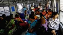 Indian women travel in the women's compartment of a train early morning in Mumbai, India, Thursday, Jan. 10, 2013. (Rafiq Maqbool/AP)