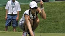 Michelle Wie of the United States lines up a putt on the 10th green during the pro-am round Wednesday at the Manulife Financial LPGA Classic in Waterloo, Ont. (MIKE CASSESE/REUTERS)