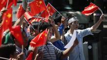 Demonstrators wave Chinese national flags during a protest outside the Japanese embassy in Beijing on Sept. 14, 2012. (David Gray/REUTERS)