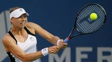 Vera Zvonareva of Russia returns a backhand to Ana Ivanovic of Serbia during the Mercury Insurance Open at the La Costa Resort and Spa on Saturday in Carlsbad, Calif. (Jeff Gross/2011 Getty Images)