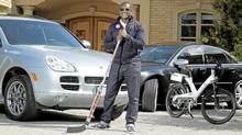 Former NHL goaltender Kevin Weekes, his Porsche Cayenne, Audi S8 and an A2B electronic bike. (Peter Power/Peter Power/The Globe and Mail)