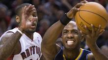 Toronto Raptors forward Sonny Weems, left, battles for the ball against Denver Nuggets guard Chauncey Billups, right, during first half NBA basketball action in Toronto on Friday, December 10, 2010. THE CANADIAN PRESS/Nathan Denette (Nathan Denette)