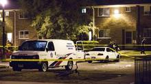 Police survey a crime scene following a shooting in Scarborough, a suburb in east Toronto, July 17, 2012. (MARK BLINCH/REUTERS)