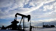 An oil pumpjack sits unused in a field north of Edmonton, February 8, 2013. (JASON FRANSON For The Globe and Mail)