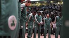 The Boston Celtics observe a moment of silence for the victims of Monday's Boston Marathon bombing, at the start of their NBA game against the Raptors in Toronto, April 17, 2013. (J.P. MOCZULSKI/J.P. MOCZULSKI)