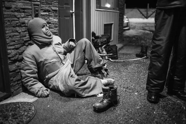 Asylum seeker Omar Ahmed tries to warm his frozen feet.