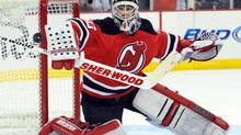 In this Feb. 18, 2012 file photo, New Jersey Devils goaltender Martin Brodeur makes a save during the first period of an NHL hockey game against the Ottawa Senators in Newark, N.J. (BILL KOSTROUN/AP)