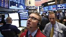 Traders work on the floor at the New York Stock Exchange on June 20, 2013. (BRENDAN MCDERMID/REUTERS)