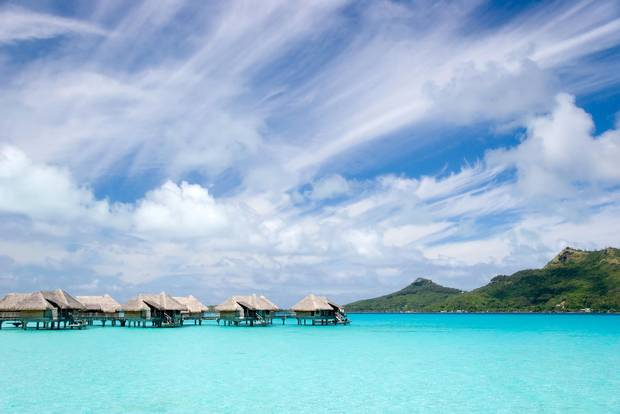 Overwater bungalows at a resort in Bora Bora, French Polynesia. Credit: Getty Images/iStockphoto