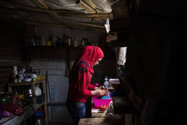 Syrian teenager Basima prepares food in a makeshift shelter in Zahle, Lebanon in May, 2015. Refugees receive about $20 U.S. per person per month from the World Food Programme