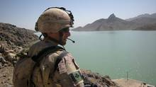 A Canadian soldier surveys the Dahla dam resevoir in 2009. (Colin Freeze/Colin Freeze/The Globe and Mail)