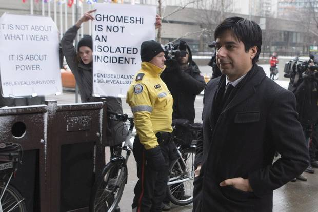 Mr. Ghomeshi walks past demonstrators as he arrives at court on Feb. 9.