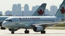An Air Canada airplane seen at Toronto Pearson International Airport, September 20, 2011. (Mark Blinch / Reuters/Mark Blinch / Reuters)