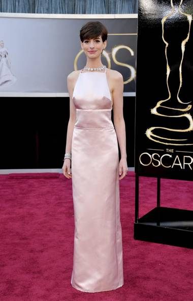 Anne Hathaway was prim in pink at the Academy Awards in Hollywood on Sunday. (John Shearer/AP)