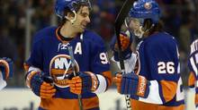 New York Islanders John Tavares and Matt Moulson celebrate (Henny Ray Abrams/AP)