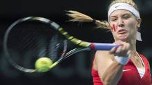 Eugenie Bouchard, of Canada, returns the ball to Jovana Jaksic, of Serbia,during round one Federation Cup tennis action in Montreal, Saturday, February 8, 2014. (Graham Hughes/THE CANADIAN PRESS)