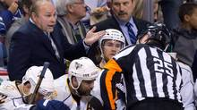 Nashville Predators head coach Barry Trotz, left, talks with referee Marc Joannette during the second period of game 1 of an NHL Western Conference semi-final Stanley Cup playoff hockey series against the Vancouver Canucks in Vancouver, B.C., on Thursday April 28, 2011. (DARRYL DYCK)