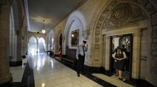 A security officer stands outside as a tour group exits the chambers of the House of Commons during a tour of Parliament in Ottawa. (Fred Lum/The Globe and Mail)