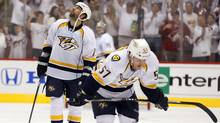 Nashville Predators' Gabriel Bourque and David Legwand head back to the bench after a Phoenix Coyotes' goal. (Ross D. Franklin/Associated Press)