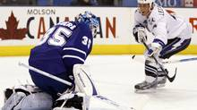 Toronto Maple Leafs goalie Jean-Sebastien Giguere makes a save on a shot by Tampa Bay Lightning forward Vincent Lecavalier during the first period of their NHL hockey game in Toronto. (MIKE CASSESE/Reuters)