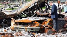 The Duke of Cambridge surveys fire damage in Slave Lake, Alta., on Wednesday, July 6, 2011. (THE CANADIAN PRESS / Jonathan Hayward/THE CANADIAN PRESS / Jonathan Hayward)