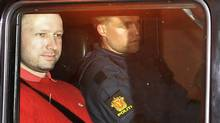 Norwegian Anders Behring Breivik (L), the man accused of a killing spree and bomb attack in Norway, sits in the rear of a vehicle as he is transported in a police convoy as he is leaving the courthouse in Oslo in this July 25, 2011 file photo. (REUTERS/Jon-Are Berg-Jacobsen/Aftenposten via Scanpix/REUTERS/Jon-Are Berg-Jacobsen/Aftenposten via Scanpix)