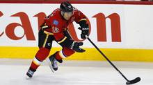 Calgary Flames' captain Jarome Iginla handles the puck during the first period of their NHL game against the St. Louis Blues in Calgary, Alberta, March 24, 2013. (TODD KOROL/REUTERS)