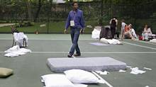 Dany Laferriere on the tennis court at the Hotel Karibe in Port-au-Prince on January 13, 2010. (Ivanoh Demers/La Presse)