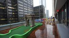 Younger staff see value in perks like the mini-putt course at Google Canada's office in Toronto. (Deborah Baic/The Globe and Mail)