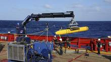 In this April 1, 2014 file photo, provided by the U.S. Navy, the Bluefin 21 autonomous sub is hoisted back on board the Australian Defense Vessel Ocean Shield after successful buoyancy testing in the Indian Ocean, as search efforts continue for missing Malaysia Airlines Flight 370. (MC1 Peter D. Blair/AP)