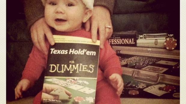 This is a photo of my son at about 7 months old. He seems to be so excited about the revelry of Christmas but at this tender age, doesn't know that we're having him pose with a poker-themed gift! (From Leigh Chapman, Toronto)