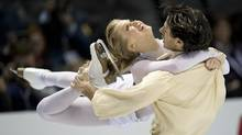 In this file photo, Canada's Kaitlyn and Weaver Andrew Poje perform their free dance in the ice dance competition at the World Figure Skating Championships Saturday, March 16, 2013 in London, Ont. The duo finished second during the ice dancing competition at the U.S. International Figure Skating Classic on Saturday in Salt Lake City. (PAUL CHIASSON/THE CANADIAN PRESS)