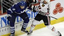 Toronto Maple Leafs defenseman Luke Schenn, left, is checked by Chicago Blackhawks Brandon Bollig in the first period of their NHL hockey game in Chicago February 29, 2012 (FRANK POLICH/REUTERS)