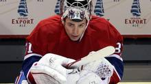 Montreal Canadiens goalie Carey Price (31) watches the final seconds from the bench of a 5-3 loss to the Carolina Hurricanes during third period National Hockey League action Monday, February 13, 2012 in Montreal. (Ryan Remiorz/THE CANADIAN PRESS)