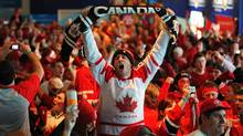 Fans in Canada House cheer Canada's 3-2 gold medal hockey victory over the U.S. at the 2010 Vancouver Olympic Winter Games. (Scott Gardner/The Canadian Press)