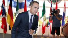 A sharp war of words ensured between Bank of Canada head Mark Carney, above, who is co-ordinating the reforms as head of the Financial Stability Board, and JPMorgan Chase & Co. CEO Jamie Dimon. (Jeff McIntosh/THE CANADIAN PRESS)