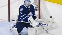 Toronto Maple Leaf goalie Jonathan Bernier (45) deflects a shot on net during 3rd period NHL play Oct 17, 2013 in Toronto. (MOE DOIRON/THE GLOBE AND MAIL)