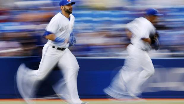 Toronto Blue Jays' Jose Bautista and Melky Cabrera (R) take the field before they play the Atlanta Braves during the first inning. (MARK BLINCH/REUTERS)