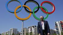 IOC President Jacques Rogge poses in front of the Olympic rings during his visit to the Athletes' Village at the Olympic Park, Monday in London. (Jae C. Hong/AP)