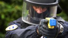 A policeman conducts a demonstration of a Taser electroshock weapon in The Netherlands on March 27, 2009. (Robin Utrecht/AFP/Getty Images/Robin Utrecht/AFP/Getty Images)