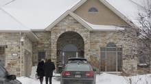 People arrive at the home of the late Mafia boss Vito Rizzuto in Sainte-Dorothée, Que., on Dec. 23, 2013. (GRAHAM HUGHES FOR THE GLOBE AND MAIL)
